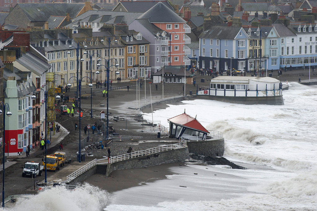 . Waves ravage an already damaged Victorian shelter on the promenade on January 7, 2014 in Aberystwyth, Wales, United Kingdom. A major clean-up operation has started today in the town after the worst storms to affect the Welsh coastline in 15 years. (Photo by Matthew Horwood/Getty Images)