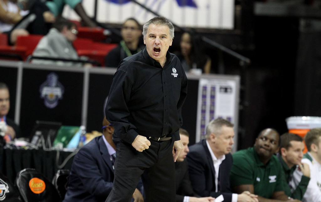 . Colorado State head coach Larry Eustachy instructs his team during the second half of a Mountain West Conference tournament NCAA college basketball game against Utah State Wednesday, March 12, 2014, in Las Vegas. Utah State defeated Colorado State 73-69. (AP Photo/Isaac Brekken)