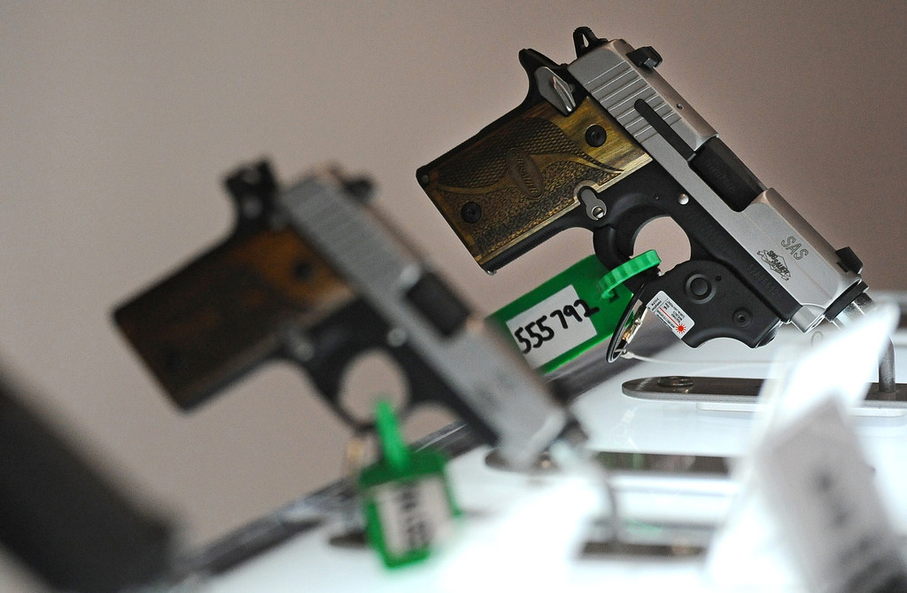 . Weapons are displayed at the Defense and Security Equipment International (DSEI) arms fair at the ExCeL centre in east London, on September 10, 2013.  AFP PHOTO / BEN STANSALL/AFP/Getty Images