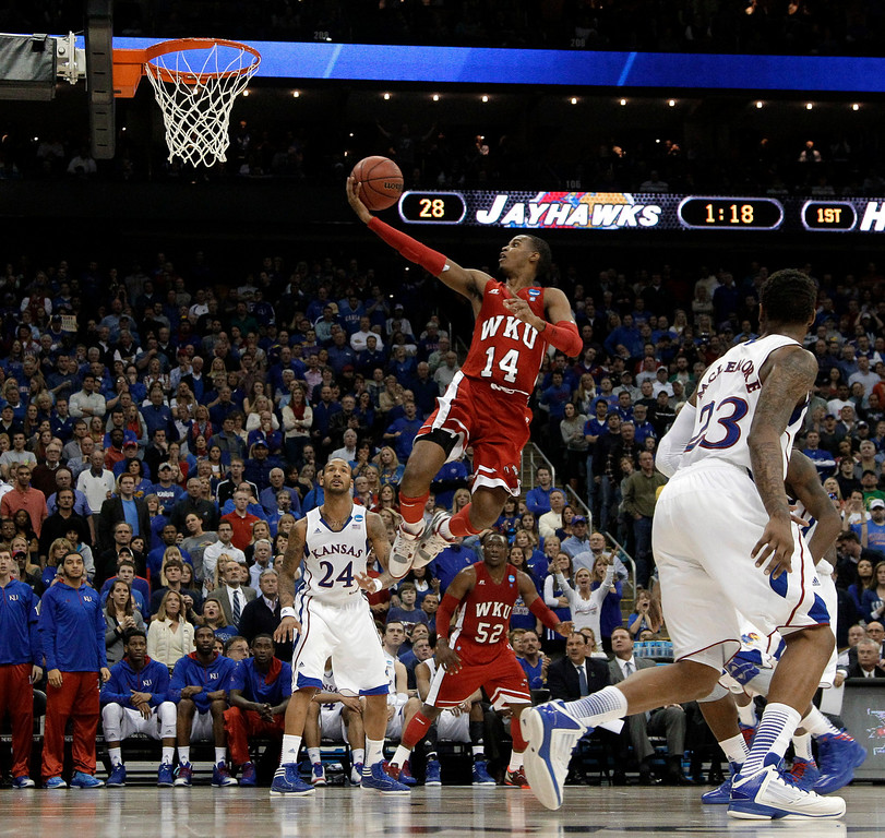 . Western Kentucky guard Jamal Crook goes in for a shot during the first half of a second-round game against Kansas in the NCAA men\'s college basketball tournament Friday, March 22, 2013, in Kansas City, Mo. (AP Photo/Charlie Riedel)
