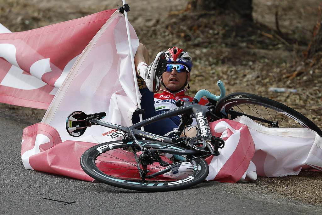 . Netherlands\' Johnny Hoogerland is seen on a floor after a fall during the 213 km first stage of the 100th edition of the Tour de France cycling race on June 29, 2013 between Porto-Vecchio and Bastia, on the French Mediterranean Island of Corsica.  AFP PHOTO / JOEL SAGET/AFP/Getty Images