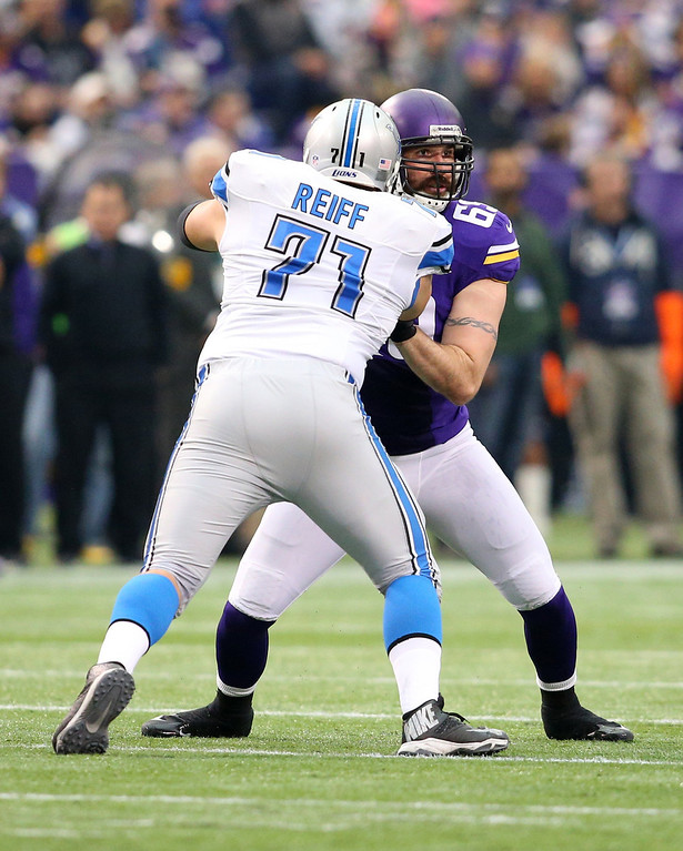 . Jared Allen #69 of the Minnesota Vikings looks for the quarterback while Riley Reiff #71 of the Detroit Lions blocks him on December 29, 2013 at Mall of America Field at the Hubert H. Humphrey Metrodome in Minneapolis, Minnesota. (Photo by Adam Bettcher/Getty Images)