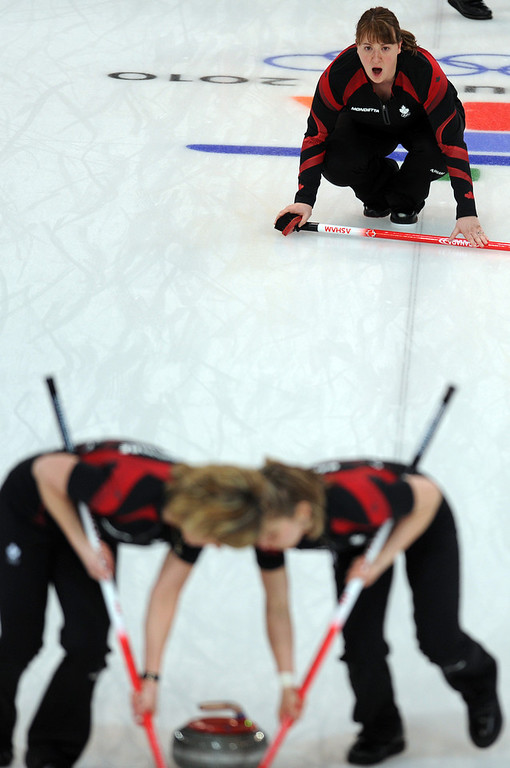 . Canada\'s third Susan O\'Connor checks the direction during the women\'s curling gold medal match Canada vs Sweden games at the Vancouver Olympic Centre, on February 26, 2010 during the Vancouver Winter Olympics.    (DIMITAR DILKOFF/AFP/Getty Images)