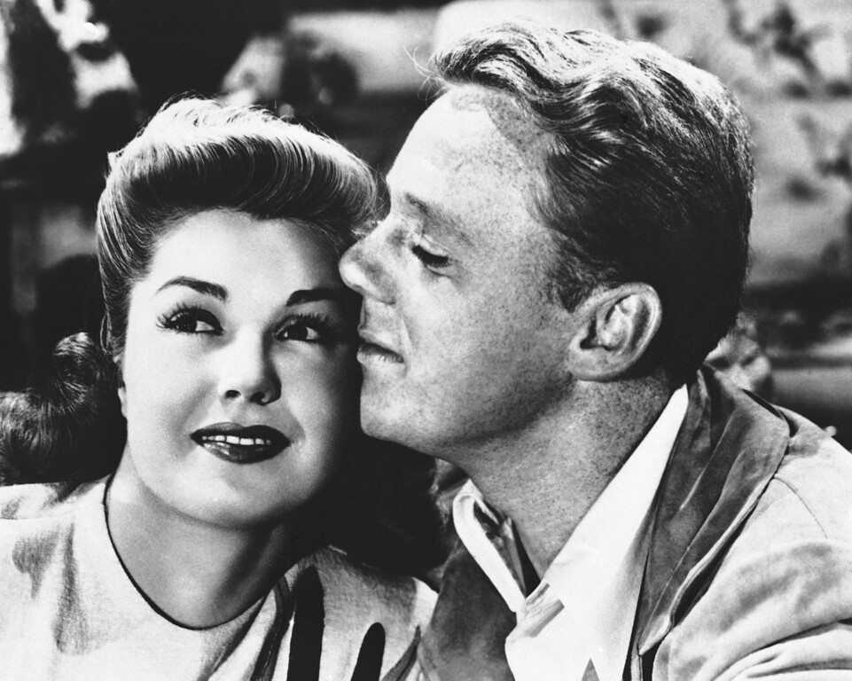 . Actress Esther Williams, left, shown with Van Johnson, while filming a scene for the musical Early to Wed, Jan. 4, 1946. (AP Photo)