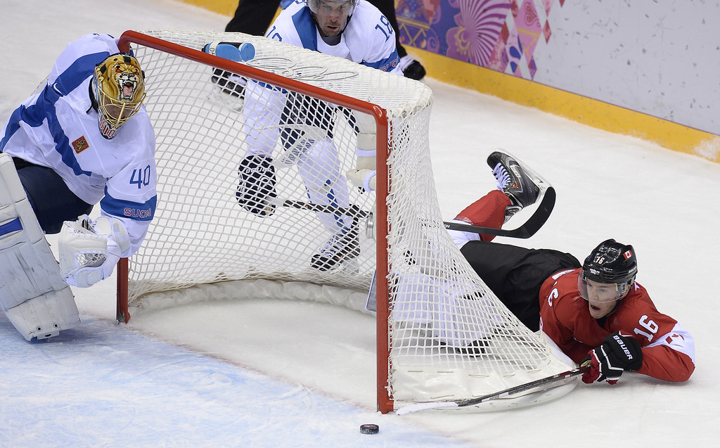 . Canada\'s Jonathan Toews tries to score past Finland\'s goalkeeper Tuukka Rask during the Men\'s Ice Hockey Group B match Finland vs Canada at the Bolshoy Ice Dome during the Sochi Winter Olympics on February 16, 2014 in Sochi. ALEXANDER NEMENOV/AFP/Getty Images