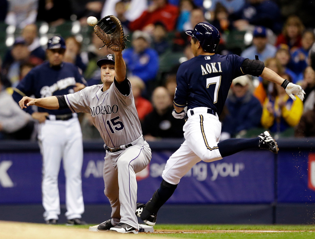 . Milwaukee Brewers\' Norichika Aoki (7) is out at the bag as Colorado Rockies\' Jordan Pacheco takes the throw during the first inning of a baseball game, Wednesday, April 3, 2013, in Milwaukee. (AP Photo/Jeffrey Phelps)