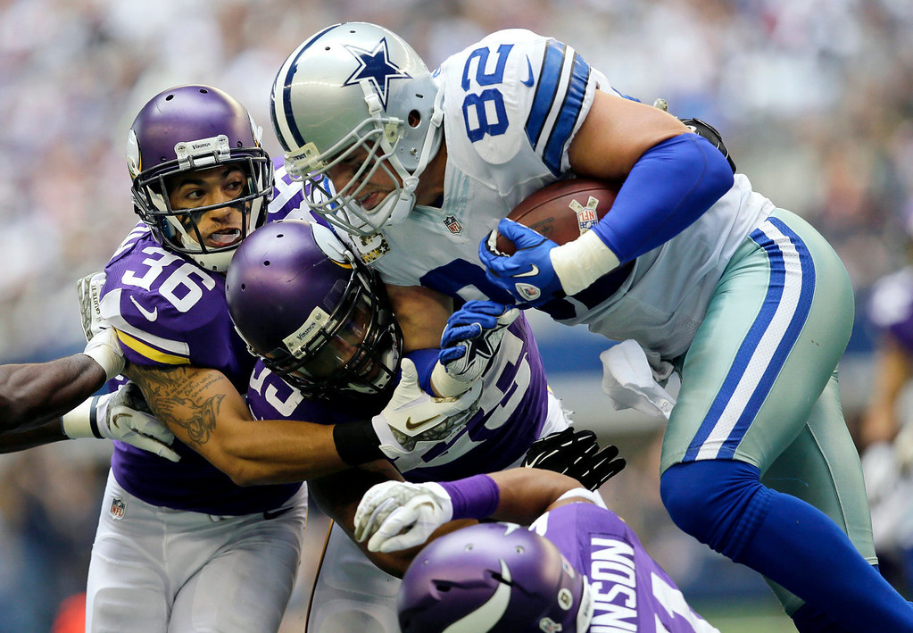 . Minnesota Vikings\' Robert Blanton (36), Marcus Sherels, center, and Josh Robinson, bottom, combine to stop Dallas Cowboys tight end Jason Witten (82) during the first half of an NFL football game, Sunday, Nov. 3, 2013, in Arlington, Texas. (AP Photo/Tim Sharp)