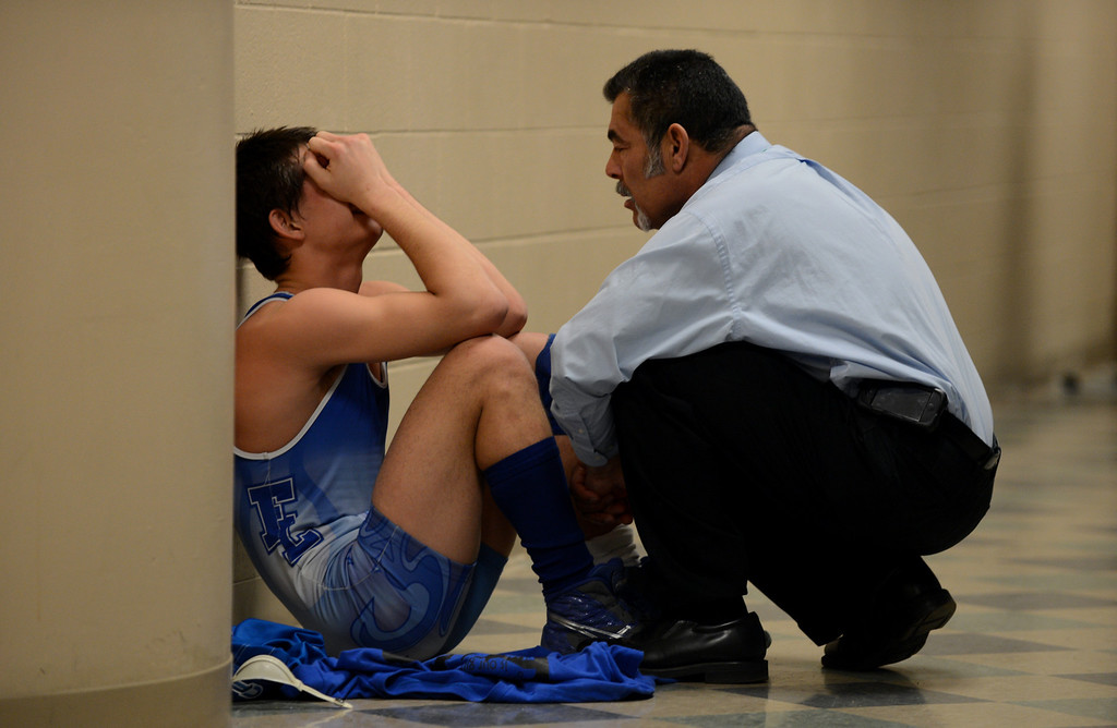 . DENVER, CO. - FEBRUARY 22: Coach Tom Galcia of Fort Lupton High School, right, comforts Zach Garcia, 145 pound class after Garcia lost his preliminary match during High School State Championship tournament at Pepsi Center February 22, 2013. Denver, Colorado. (Photo By Hyoung Chang/The Denver Post)