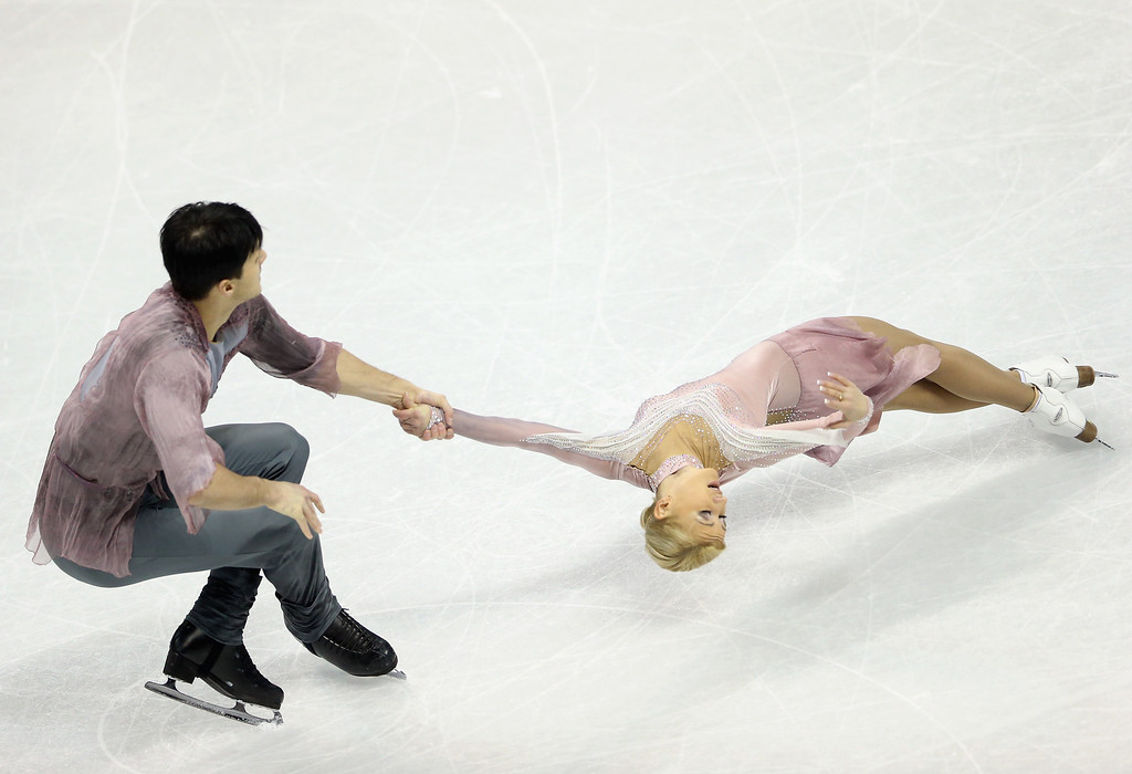 . Tatiana Volosozhar and Maxim Trankov of Russia compete in the Pairs Free Skating during the 2013 ISU World Figure Skating Championships at Budweiser Gardens on March 15, 2013 in London, Canada.  (Photo by Ronald Martinez/Getty Images)