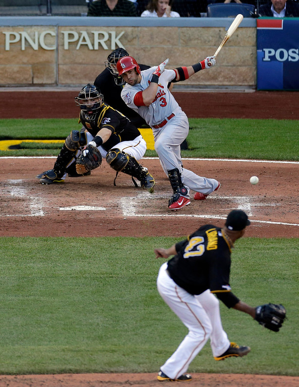 . St. Louis Cardinals\' Carlos Beltran (3) hits a single to center field driving in two runs off Pittsburgh Pirates starting pitcher Francisco Liriano (47) in the fifth inning of Game 3 of a National League baseball division series on Sunday, Oct. 6, 2013, in Pittsburgh . Pirates catcher Russell Martin is at left. (AP Photo/Tom Puskar)