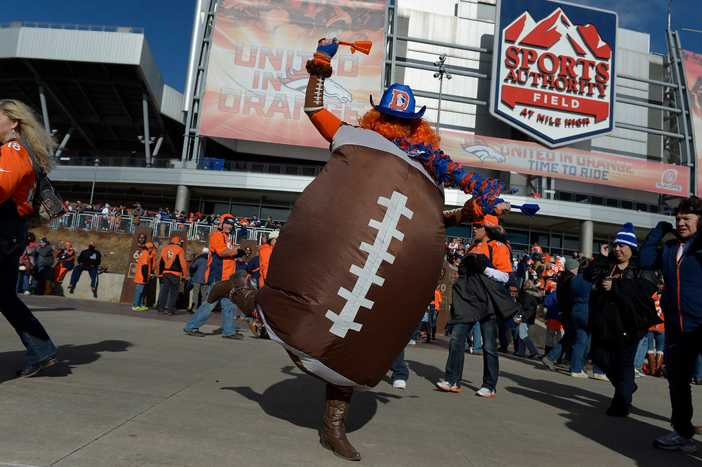 . Krissy Nicole, aka Football Lady, cheers outside the stadium. The Denver Broncos take on the San Diego Chargers at Sports Authority Field at Mile High in Denver on January 12, 2014. (Photo by Craig F. Walker/The Denver Post)