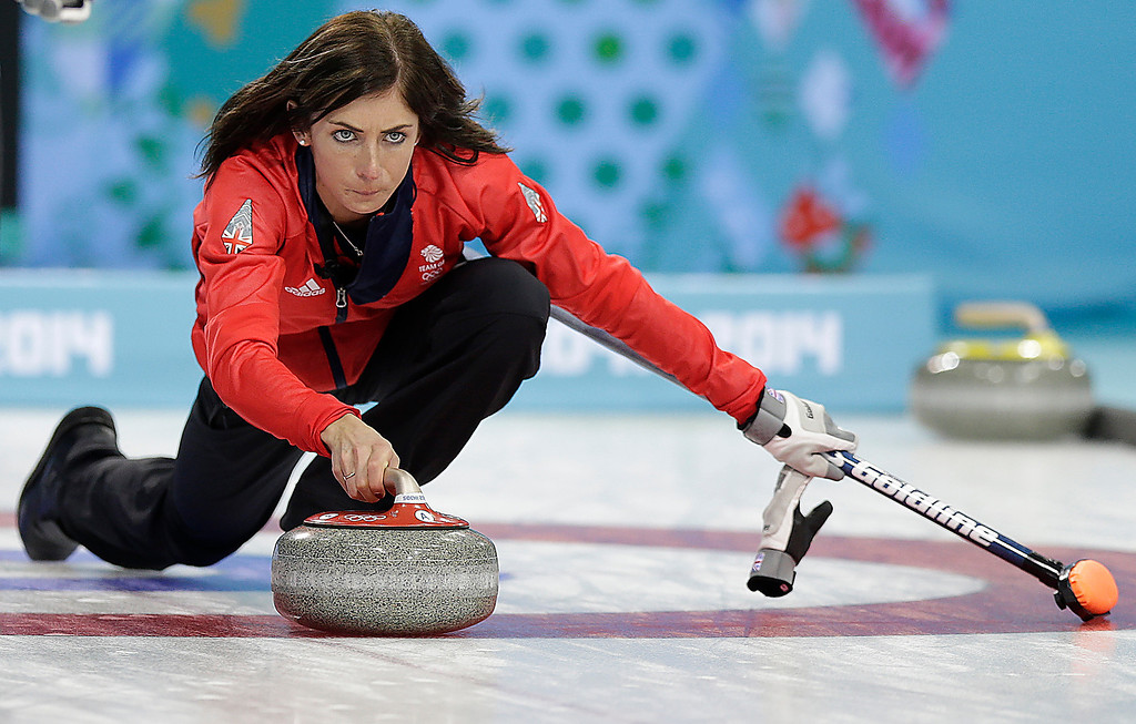 . Great Britain\'s skip Eve Muirhead delivers the rock during the women\'s curling competition against the United States at the 2014 Winter Olympics, Tuesday, Feb. 11, 2014, in Sochi, Russia. (AP Photo/Wong Maye-E)