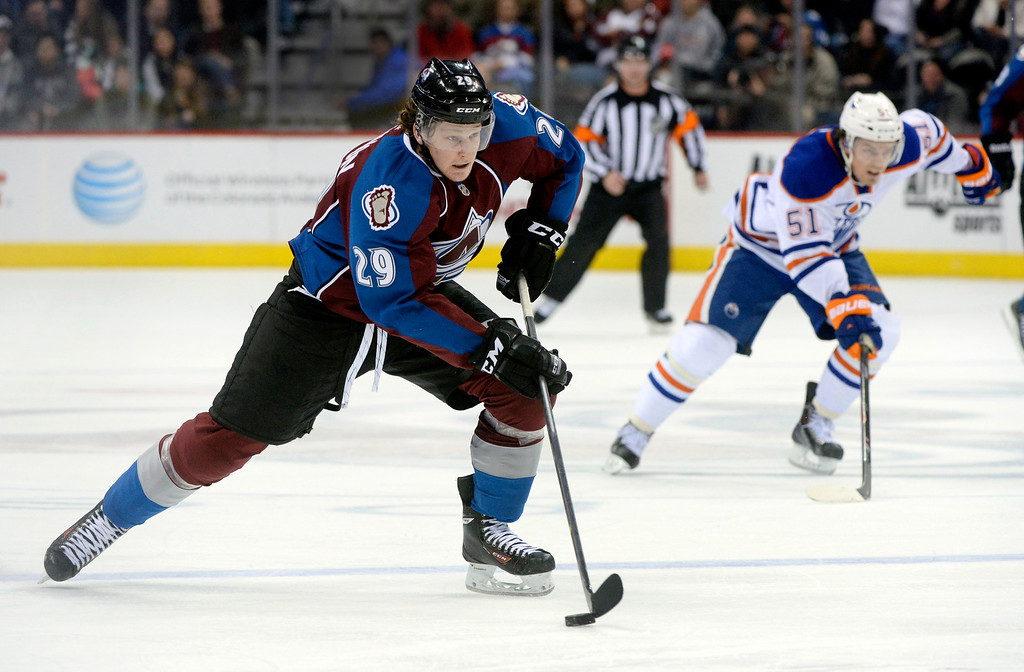 . DENVER, CO. - DECEMBER 19: Colorado center Nathan MacKinnon (29) skated with the puck in the third period. The Colorado Avalanche defeated the Edmonton Oilers 4-2 Thursday night, December 19, 2013.  Photo By Karl Gehring/The Denver Post
