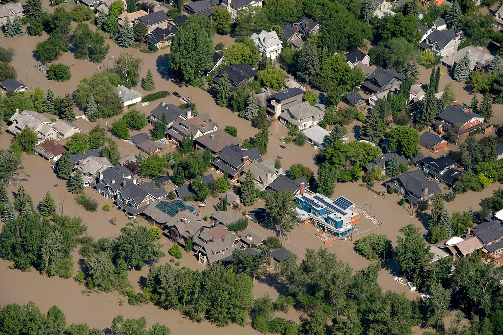 . This aerial photo shows a flooded downtown Calgary, Alberta, Canada on Saturday, June 22, 2013.  (AP Photo/The Canadian Press, Jonathan Hayward)