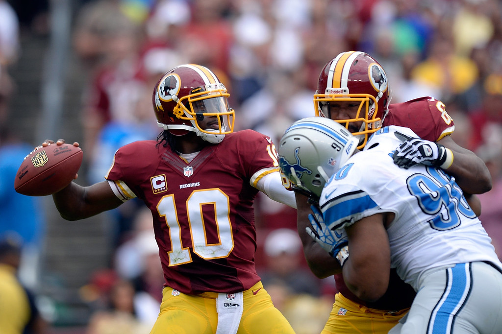 . LANDOVER, MD - SEPTEMBER 22:  Robert Griffin III #10 of the Washington Redskins throws a pass in the third quarter during a game against the Detroit Lions at FedExField on September 22, 2013 in Landover, Maryland.  (Photo by Patrick McDermott/Getty Images)