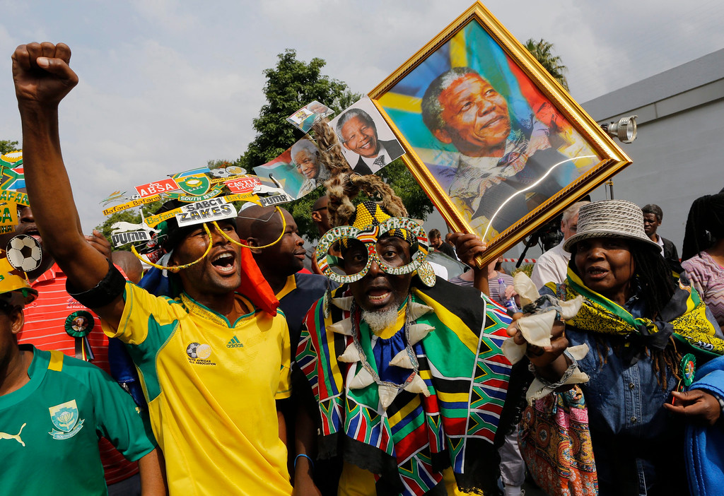 . Some of the hundreds of people paying their respects to Nelson Mandela dance and sing outside the house of the late South African president in Johannesburg, South Africa, 07 December 2013. Nobel Peace Prize winner Nelson Mandela died at age 95, in Johannesburg, South Africa, on 05 December 2013. A former lawyer, Mandela was the first black President of South Africa voted into power after the countries first free and fair democratic elections that witnessed the end of the Apartheid system in 1994. Mandela was founding member of the ANC (African National Congress) and anti-apartheid activist who served 27 years in prison, spending many of these years on Robben Island. In South Africa, Mandela is often known as Tata Madiba, an honorary title adopted by elders of Mandela\'s clan. Mandela won the Nobel Peace Prize in 1993.  EPA/KIM LUDBROOK