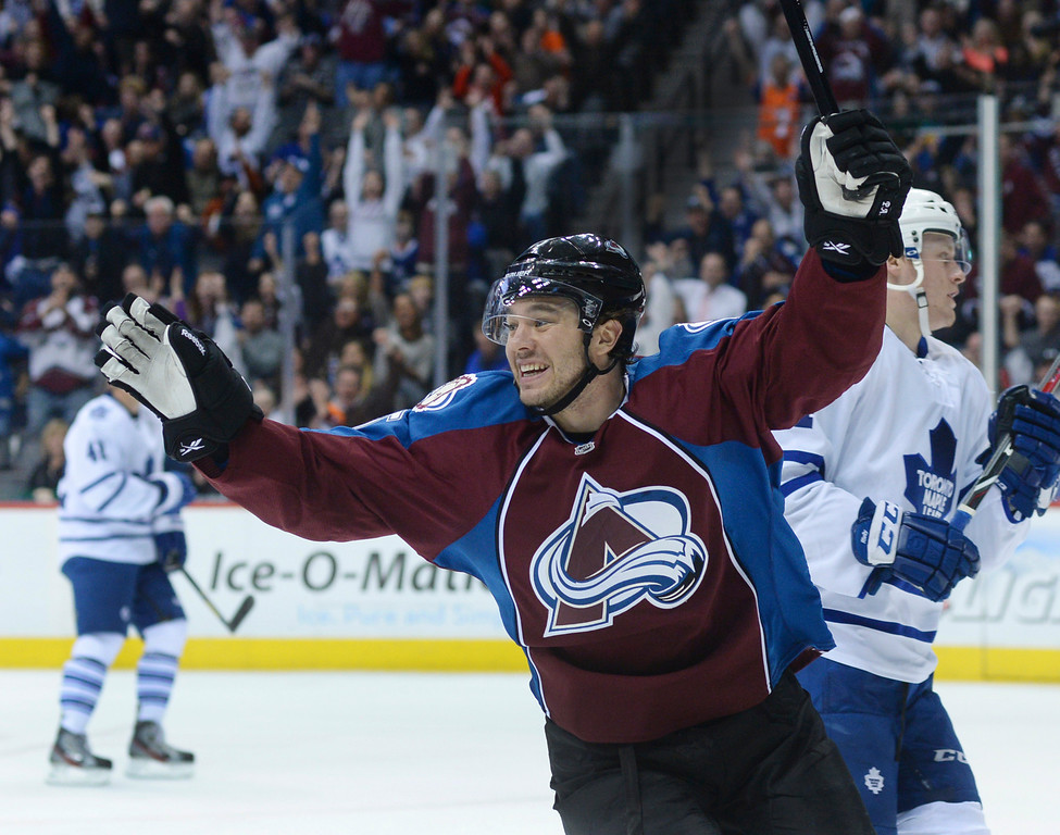 . DENVER, CO. - JANUARY 21:  Avalanche wing P.A. Parenteau celebrated as Nathan MacKinnon got his second goal of the night in the third period. The Toronto Maple Leafs defeated the Colorado Avalanche 5-2 Tuesday night, January 21, 2014 at the Pepsi Center. Photo By Karl Gehring/The Denver Post