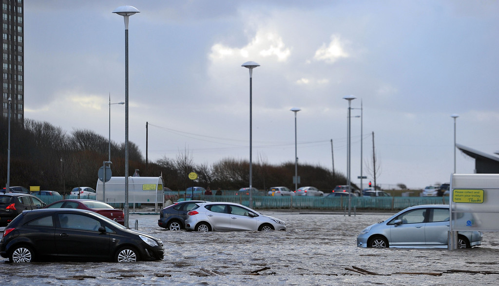 . Cars are abandoned as flood waters recede in New Brighton, north west England, on December 5, 2013 after high winds and flooding hit the north of England and Scotland.  AFP PHOTO / PAUL ELLIS/AFP/Getty Images