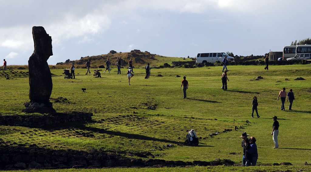 . Tourists take pictures of Moais -- stone statue of the Rapa Nui culture -- on Easter Island, 3700 km off the Chilean coast in the Pacific Ocean, on July 9, 2010. MARTIN BERNETTI/AFP/Getty Images