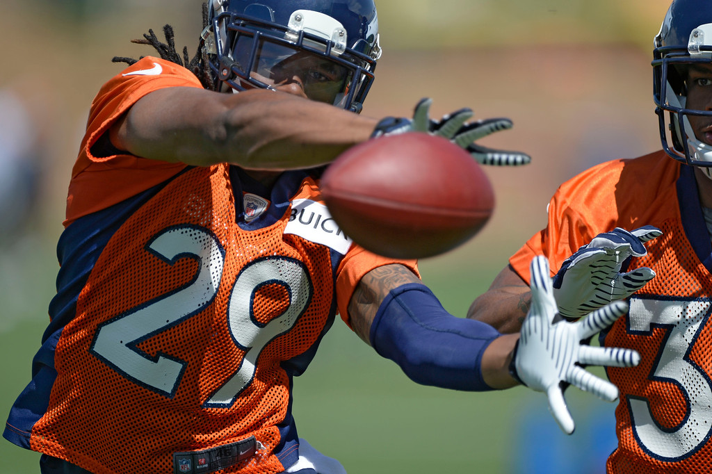 . Denver Broncos Bradley Roby (29) reaches out for the ball in drills with Louis Young (39) during OTAs June 11, 2014 at Dove Valley. (Photo by John Leyba/The Denver Post)