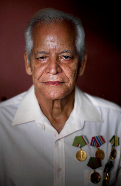 ". Claudio Rodriguez Contreras, 71, a veteran of the Cuban revolution, poses for a photo at his home in Havana, Cuba on Saturday, June 15, 2013. When asked: As you grow older, what are you most afraid of and what is the biggest problem facing the elderly in your country? Contreras said, ""Cuban elderly have no biggest fears of old age, as our revolutionary government within its means helps us with minimal requirements - a pension, free medical care, food, home, and keeps us active in society. The problem at my old age is that because of the embargo that Cuba receives, our country can not develop as it should and we can not enjoy seeing the dreams made for our children.\"" (AP Photo/Ramon Espinosa)"