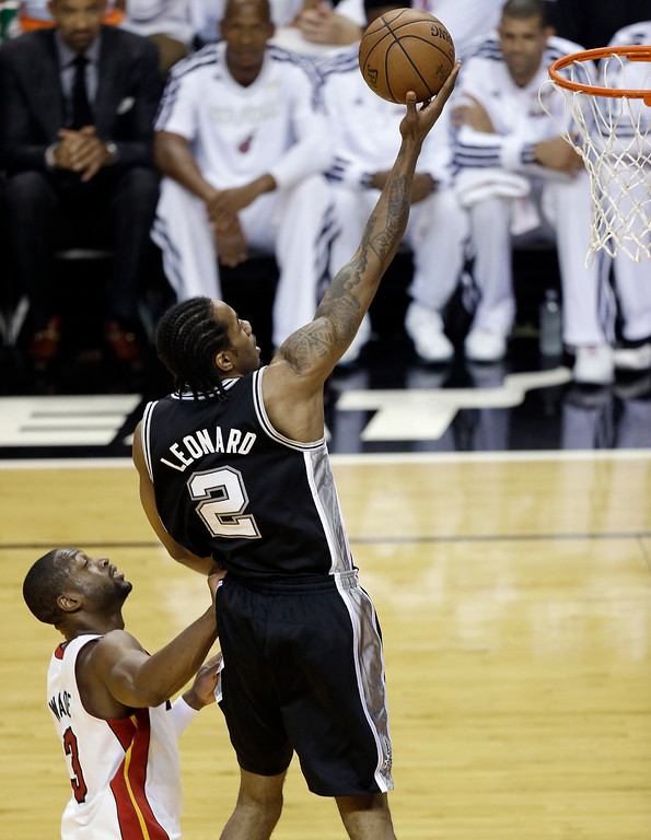 . San Antonio Spurs small forward Kawhi Leonard (2) shoots against Miami Heat shooting guard Dwyane Wade (3) during the first half of Game 6 of the NBA Finals basketball series, Tuesday, June 18, 2013 in Miami. (AP Photo/Wilfredo Lee)