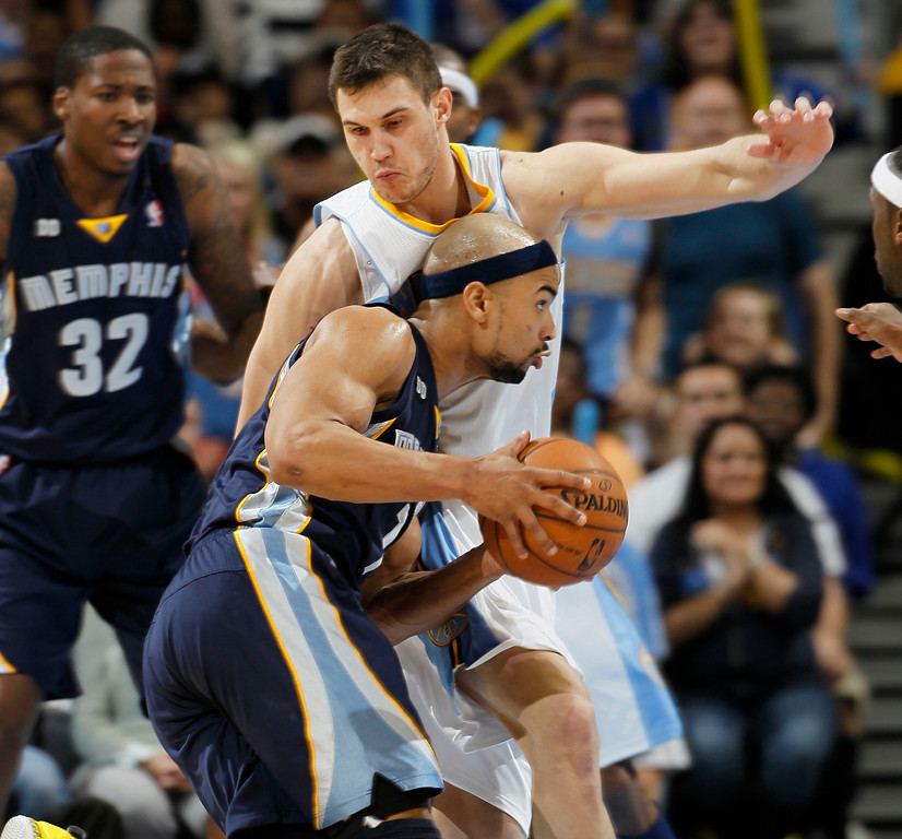 . Memphis Grizzlies guard Jerryd Bayless, front, works the ball inside against Denver Nuggets forward Danilo Gallinari, of Italy, in the third quarter of the Nuggets\' 87-80 victory in an NBA basketball game in Denver on Friday, March 15, 2013. (AP Photo/David Zalubowski)