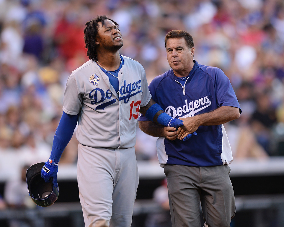 . DENVER, CO - JULY 4: Dodgers batter Hanley Ramirez walked to first base as a trainer checked on his hand after he was hit by a pitch in the fifth inning. The Colorado Rockies hosted the Los Angeles Dodgers at Coors Field Friday night, July 4, 2014.  Photo by Karl Gehring/The Denver Post