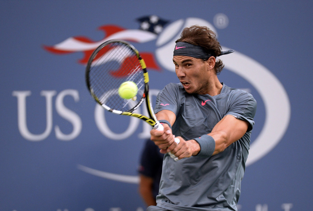 . Rafael Nadal of Spain plays a shot against Novak Djokovic of Serbia during the 2013 US Open men\'s singles final at the USTA Billie Jean King National Tennis Center in New York on September 9, 2013.    TIMOTHY CLARY/AFP/Getty Images