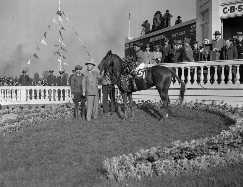 . Conn McCreary sits astride Pensive May 6, 1944 in the winner\'s circle at Louisville Ky. after riding owner Warren Wright\'s Colby to victory in the richest Derby in history. Left is trainer Ben Jones and holding horse is owner Wright, of Chicago. Pensive won at Preakness, but finished second to Bounding Home at Belmont. (AP photo/JR)