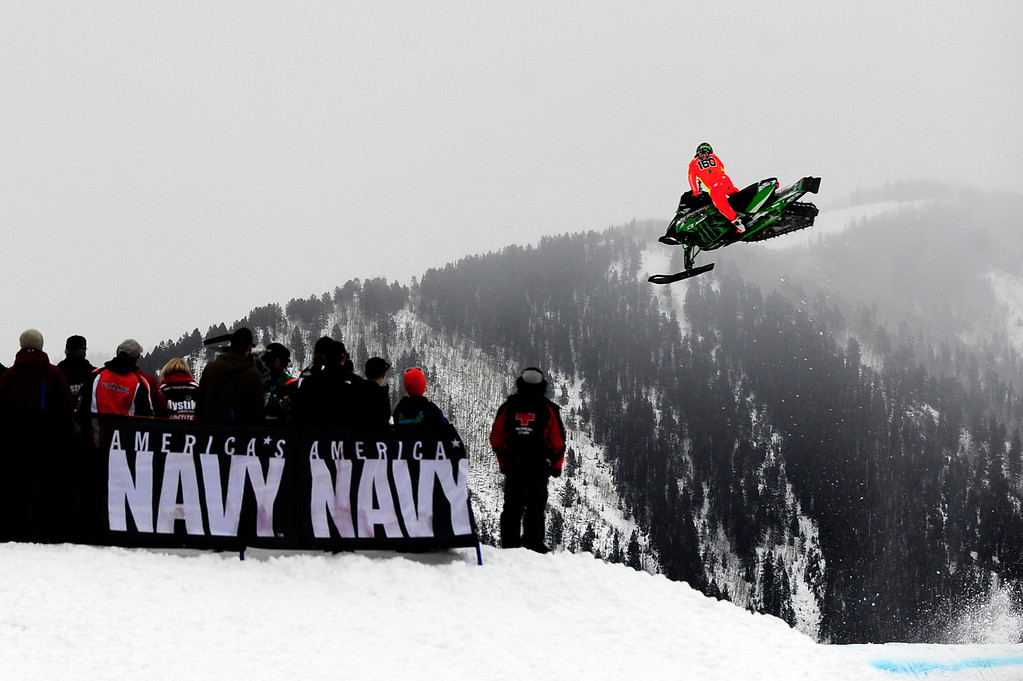 . ASPEN, CO - January 26: Cory Davis goes off a jump as spectators look on during the Snowmobile Speed & Style event at Winter X Games Aspen 2013 at Buttermilk Mountain on Jan. 26, 2013, in Aspen, Colorado. Davis won silver in the event. (Photo by Daniel Petty/The Denver Post)
