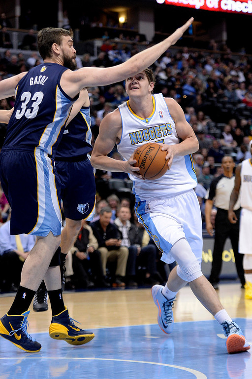 . Memphis Grizzlies center Marc Gasol (33) fouls Denver Nuggets center Timofey Mozgov (25) during the first quarter. (Photo by AAron Ontiveroz/The Denver Post)