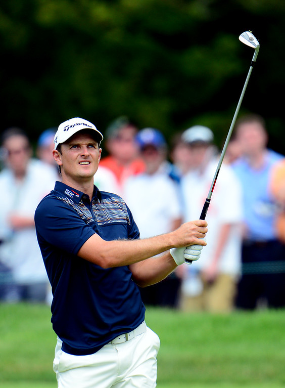 . ARDMORE, PA - JUNE 16:  Justin Rose of England hits his second shot on the first hole during the final round of the 113th U.S. Open at Merion Golf Club on June 16, 2013 in Ardmore, Pennsylvania.  (Photo by David Cannon/Getty Images)