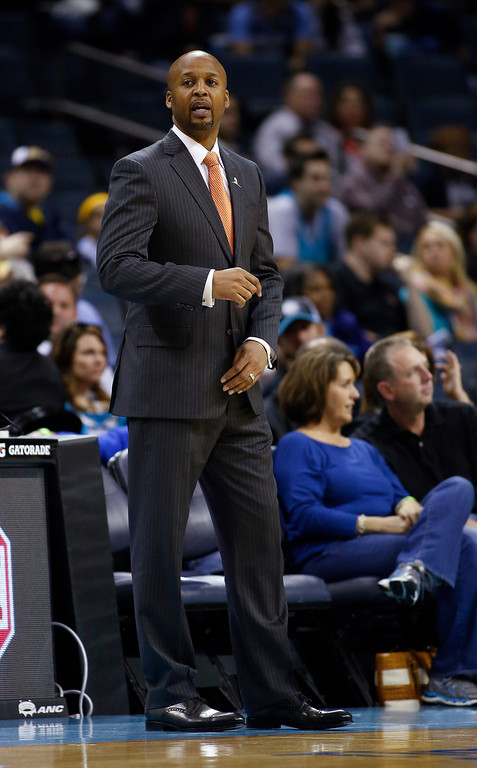 . Denver Nuggets coach Brian Shaw watches as his team plays against the Charlotte Bobcats during the second half of an NBA basketball game in Charlotte, N.C., Monday, March 10, 2014. Charlotte won 105-98. (AP Photo/Nell Redmond)