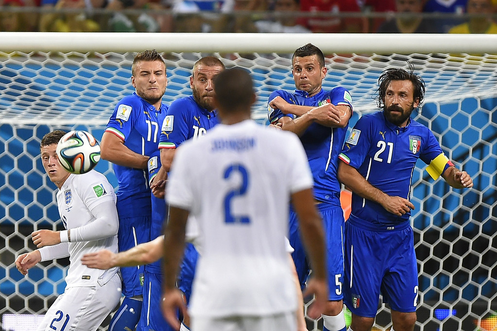 . Italy\'s forward Ciro Immobile(2L), Italy\'s midfielder Daniele De Rossi (3L), Italy\'s midfielder Thiago Motta (2R) and Italy\'s midfielder Andrea Pirlo (R) jump during a free kick as England\'s midfielder Ross Barkley (L) and England\'s defender Glen Johnson (front) watch on during a Group D football match between England and Italy at the Amazonia Arena in Manaus during the 2014 FIFA World Cup on June 14, 2014.  AFP PHOTO / FABRICE COFFRINI