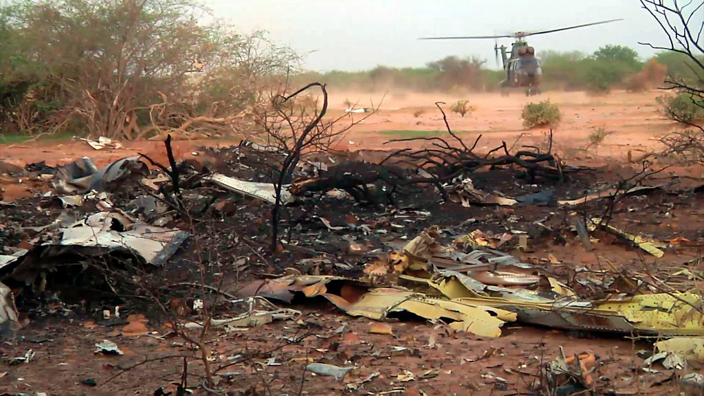 . This photo provided Friday July 25, 2014 by the French army shows a helicopter at the site of the plane crash in Mali. French soldiers secured a black box from the Air Algerie wreckage site in a desolate region of restive northern Mali on Friday, the French president said. (AP Photo/ECPAD)