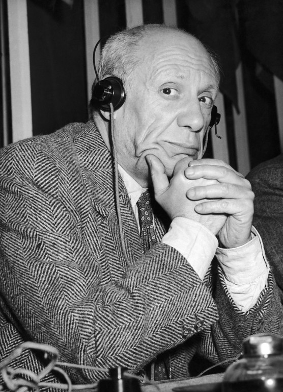 . Spanish artist Pablo Picasso listens to the translation of a speech at the World Congress of Partisans of Peace during the session of the communist-Dominated rally in Paris, France on April 23, 1949. (AP Photo/Jean Jacques Levy)