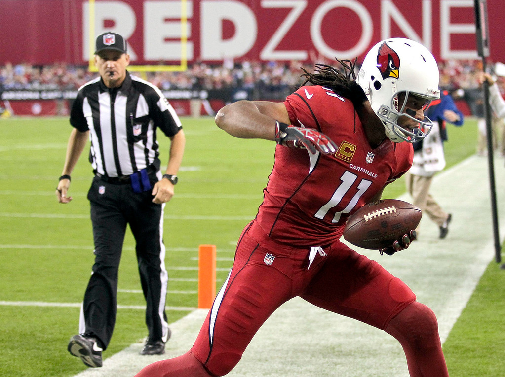 . Arizona Cardinals wide receiver Larry Fitzgerald (11) steps out of bounds after making a touchdown catch against the Indianapolis Colts during the first half of an NFL football game, Sunday, Nov. 24, 2013, in Glendale, Ariz. (AP Photo/Rick Scuteri)