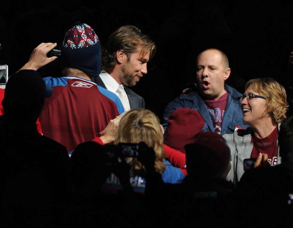 . Peter Forsberg walked through the crowd on the way to the ice for his ceremony Saturday night.  The Colorado Avalanche retired Peter Forsberg\'s #21 jersey in a ceremony at the Pepsi Center Saturday night.  Forsberg\'s 19-year professional career included 13 years in the National Hockey League where he won two Stanley Cups with the Avs. The Colorado Avalanche hosted the Detroit Red Wings in the season opener Saturday night, October 8, 2011.  Karl Gehring/The Denver Post