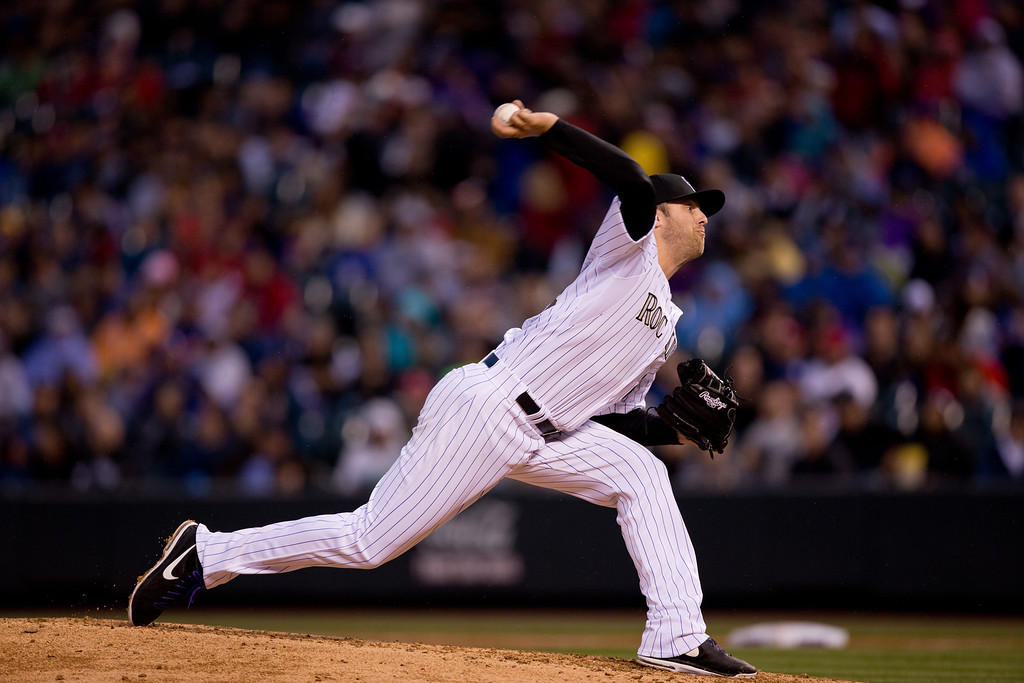. Starting pitcher Jordan Lyles #24 of the Colorado Rockies delivers to home plate during the fourth inning against the Philadelphia Phillies at Coors Field on April 19, 2014 in Denver, Colorado.  (Photo by Justin Edmonds/Getty Images)