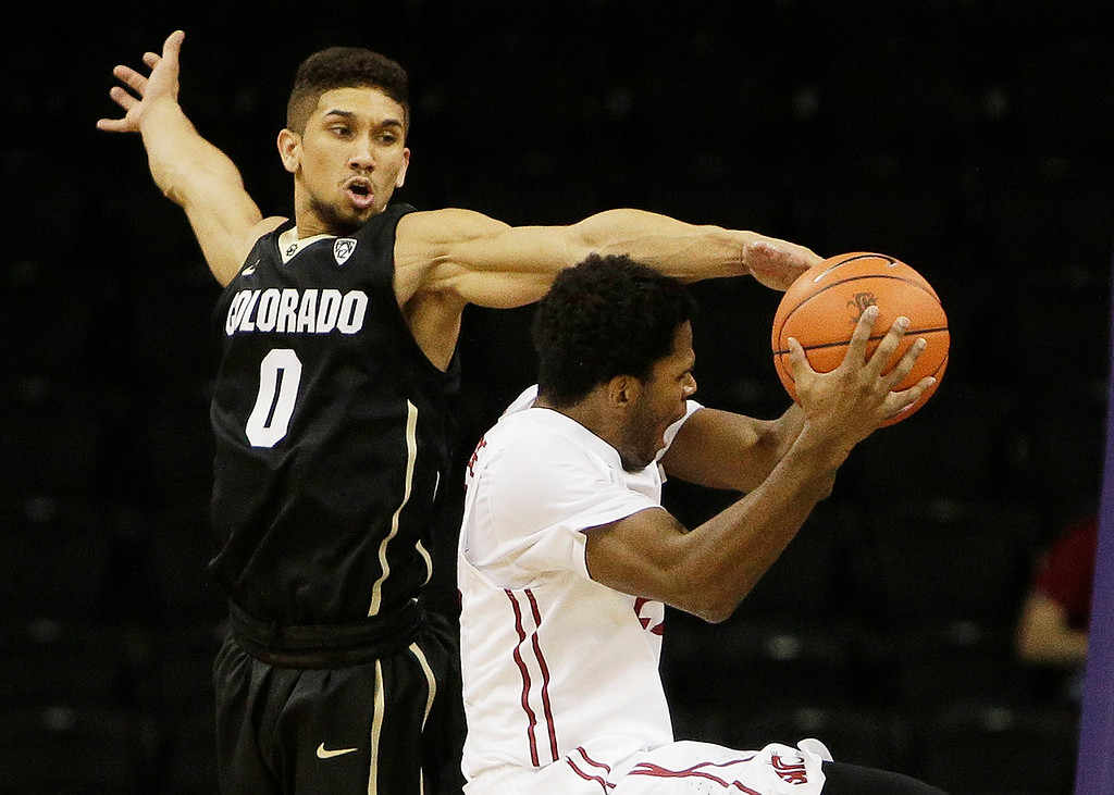 . Washington State\'s Royce Woolridge attempts a layup against Coloradoís Askia Booker (0) during the second half of an NCAA college basketball game on Wednesday, Jan. 8, 2014, in Spokane, Wash. Colorado won 71-70 in overtime. (AP Photo/Young Kwak)