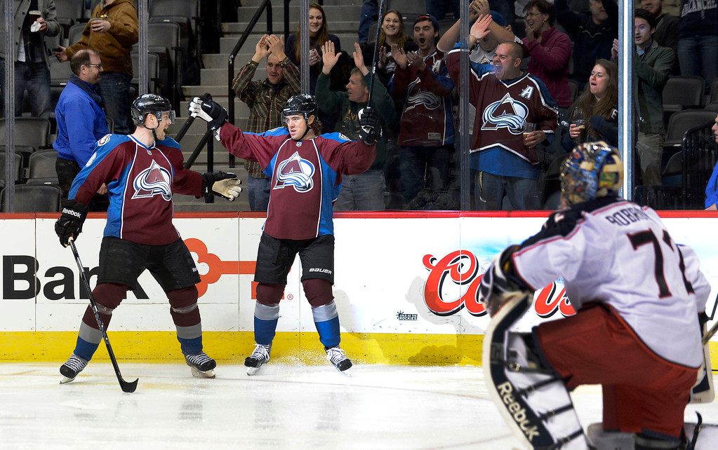 . DENVER, CO. - JANUARY 24: Colorado Avalanche right wing P.A. Parenteau (15) celebrates his first period goal with teammate Colorado Avalanche defenseman Jan Hejda (8) as Columbus Blue Jackets goalie Sergei Bobrovsky (72) looks on January 24, 2013 at Pepsi Center. The Colorado Avalanche take on the Columbus Blue Jackets.   (Photo By John Leyba / The Denver Post)