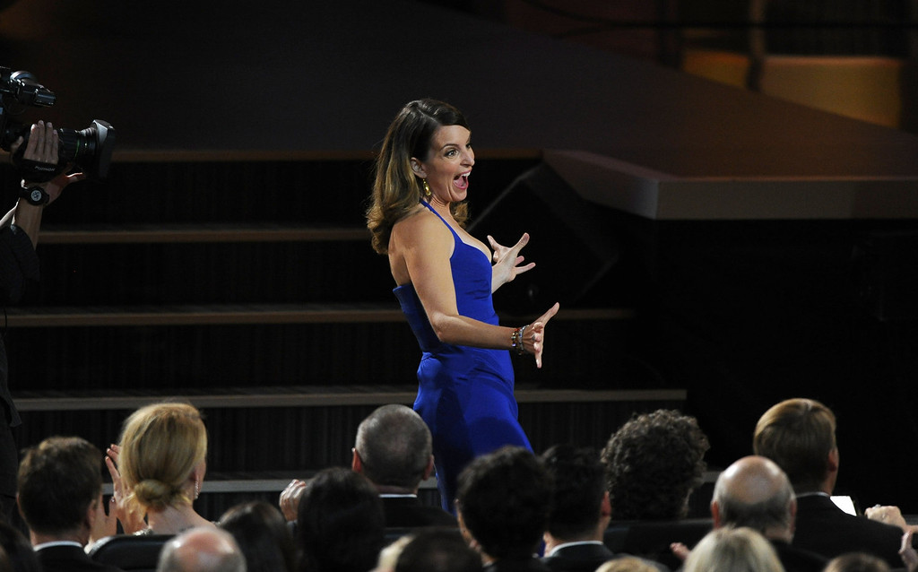. Tina Fey walks to the stage to accept the award for outstanding writing for a comedy series for ì30 Rockî at the 65th Primetime Emmy Awards at Nokia Theatre on Sunday Sept. 22, 2013, in Los Angeles.  (Photo by Chris Pizzello/Invision/AP)