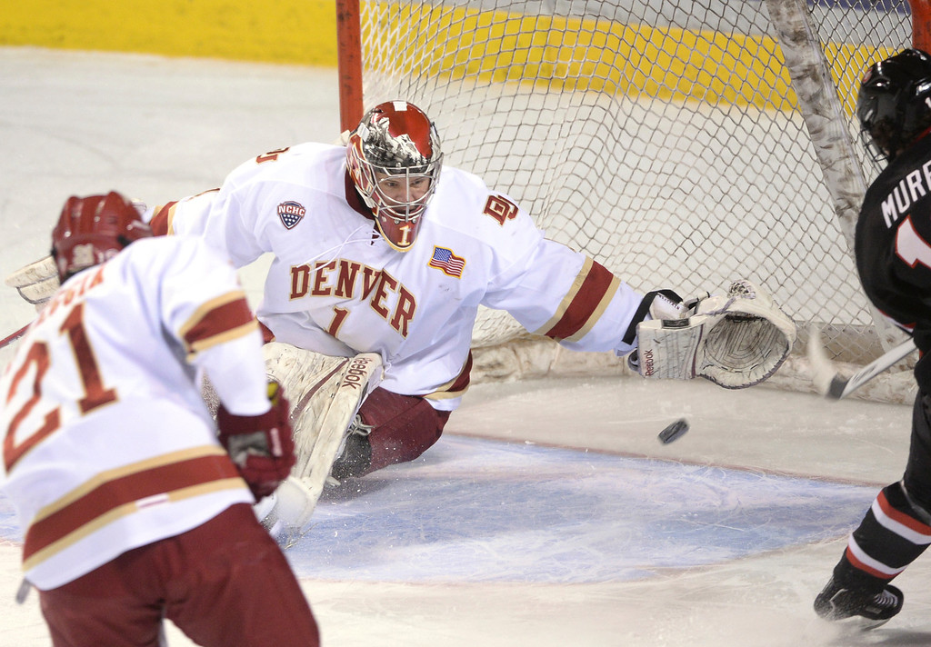 . DENVER, CO. - JANUARY 10: Huskies\' right wing Jimmy Murray (16) slapped a shot past Denver goaltender Sam Brittain to tie the game in the first period. The University of Denver hockey team hosted St. Cloud State at Magness Arena Friday night, January 10, 2014. Photo By Karl Gehring/The Denver Post