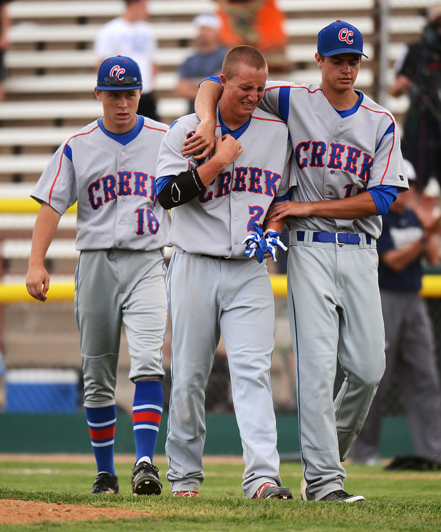 . DENVER, CO. - MAY 24 :From left, Grant Farrell (16), Griffin Jax (22) and Dimitri Casas (15) of Cherry Creek High School are leaving the field after losing semifinal round of 5A State Championships baseball game against ThunderRidge High School at All City Field. Denver, Colorado. May 24, 2013. ThunderRidge won 5-1. (Photo By Hyoung Chang/The Denver Post)