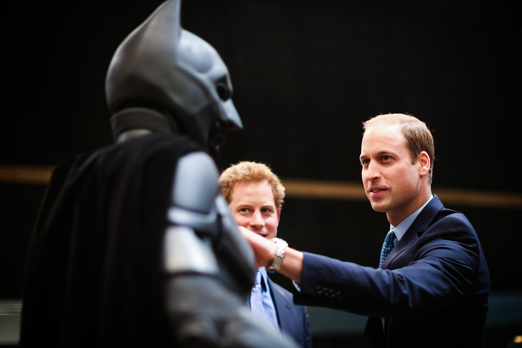 . Prince Harry and Prince William, Duke of Cambridge inspect the Batman costume during the Inauguration Of Warner Bros. Studios Leavesden on April 26, 2013 in London, England.  (Photo by Paul Rogers - WPA Pool/Getty Images)