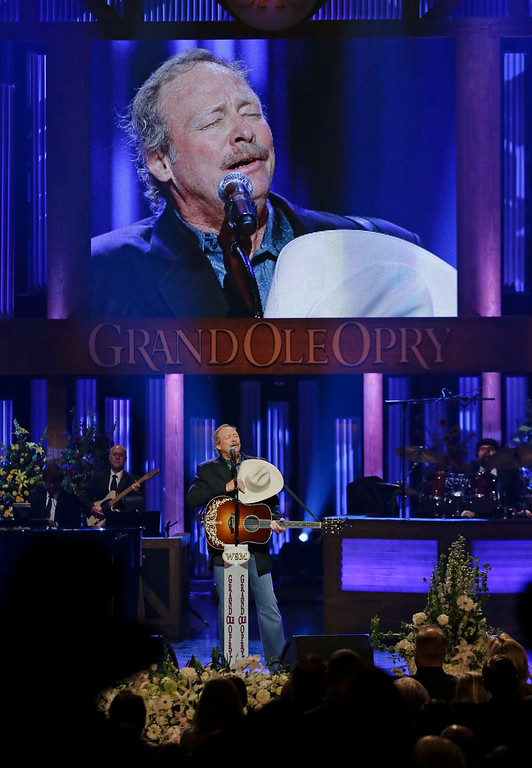 ". Alan Jackson sings ""He Stopped Loving Her Today\"" to close the funeral for country music star George Jones in the Grand Ole Opry House on Thursday, May 2, 2013, in Nashville, Tenn. Jones, one of country music\'s biggest stars who had No. 1 hits in four separate decades, died April 26.  (AP Photo/Mark Humphrey, Pool)"