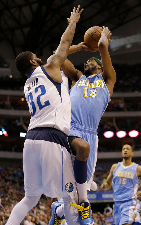 . Denver Nuggets small forward Corey Brewer (13) shoots against Dallas Mavericks shooting guard O.J. Mayo (32) during the first half of an NBA basketball game on Friday, April 12, 2013, in Dallas. (AP Photo/LM Otero)