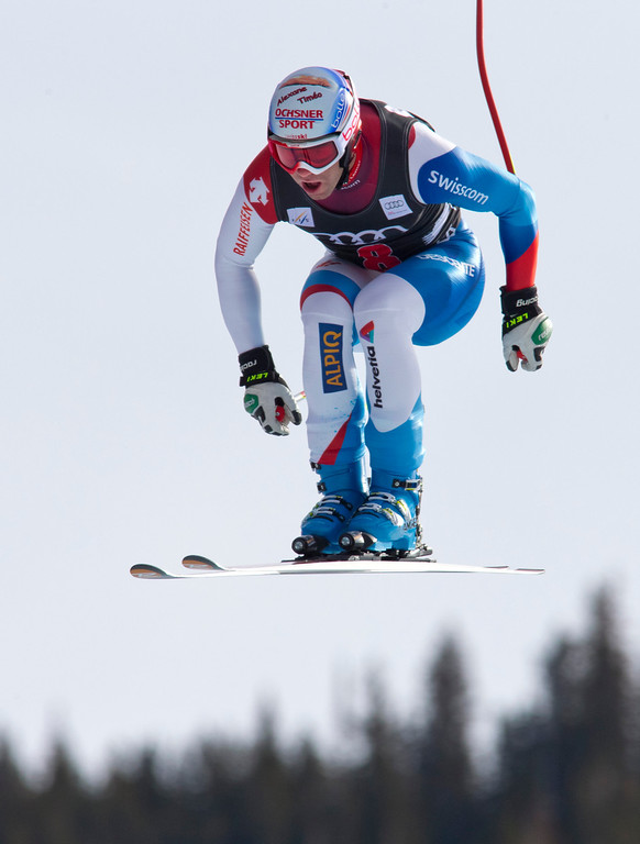 . Didier Defargo of Switzerland, is airborne as he races down the course during the men\'s World Cup downhill ski race in Beaver Creek, Colo., on Friday, Nov. 30, 2012. (AP Photo/Nathan Bilow)