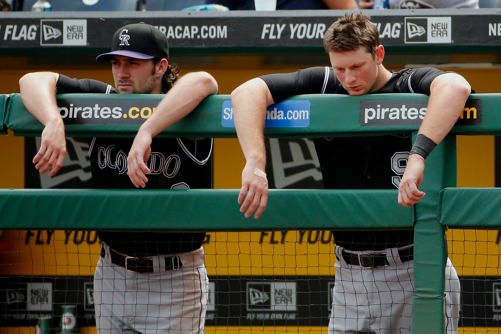 . Colorado Rockies\' DJ LeMahieu, right, and Charlie Culberson, left, stand in the dugout during the seventh inning of a baseball game against the Pittsburgh Pirates in Pittsburgh on Sunday, July 20, 2014. The Pirates won 5-3. (AP Photo/Gene J. Puskar)